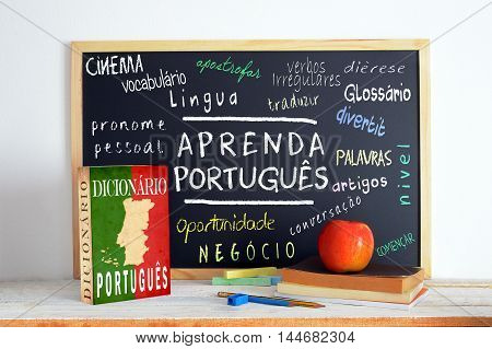 Blackboard in a language class with the text LEARN PORTUGUESE