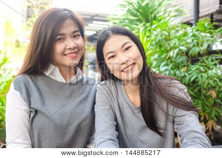 Portrait Of A Beautiful Couple Asian Woman Casual Smiling Outdoor