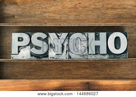 psycho word made from metallic letterpress type on wooden tray