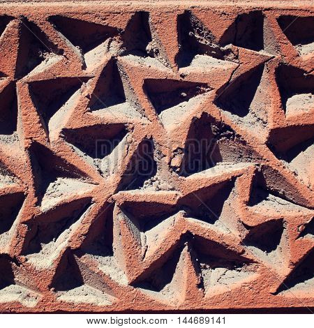 Triangular Grooves In The Concrete Wall. Close Up.