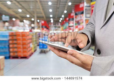 Hand Of Businessman, Manger Use Mobile Tablet In Supermarket