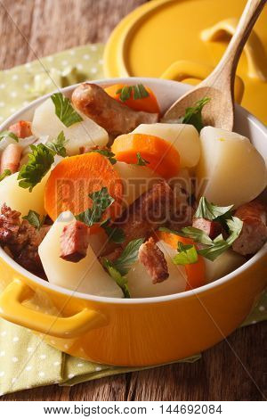 Dublin Coddle Of Roughly Sliced Pork Sausages And Potatoes, Onions Closeup. Vertical