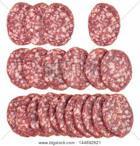 Slices of salami sausages isolated on a white background. Top view.