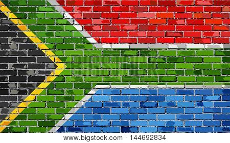 Flag of South Africa on a brick wall - Illustration,  South African flag on brick textured background,  Abstract grunge mosaic vector