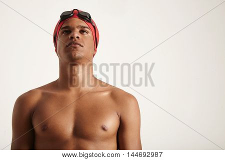 Young African American Swimmer In Red Cap And Black Goggles Looking Up