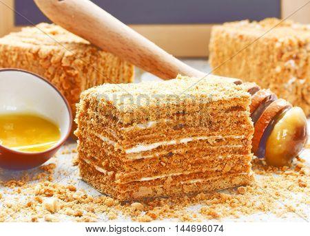 Slice of layered honey cake selective focus