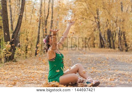 Happy Woman Playing With Autumn Leaves.