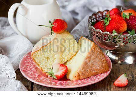 Traditional Italian sponge cake pan di spagna with strawberry and custard rustic style selective focus
