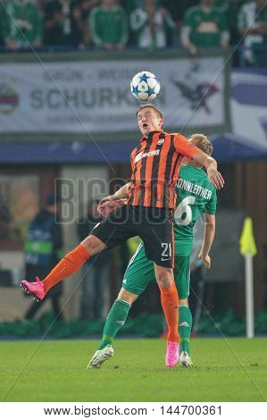 VIENNA, AUSTRIA - AUGUST 19, 2015: Olexandr Gladkiy (FC Shakhtar) and Mario Sonnleitner (SK Rapid) fight for the ball in an UEFA Champions League qualification game.