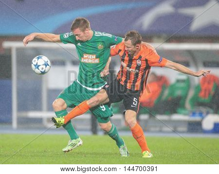 VIENNA, AUSTRIA - AUGUST 19, 2015: Robert Beric (SK Rapid) and  Olexandr Kucher (FC Shakhtar) fight for the ball in an UEFA Champions League qualification game.
