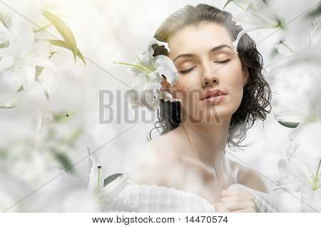 a beautiful girl in the flower garden