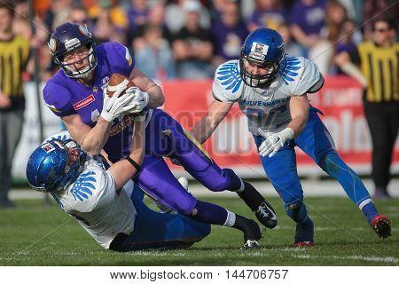 VIENNA, AUSTRIA - APRIL 3, 2016: Luka Klaric (Ljubljana Silverhawks) tackles Manuel Thaller (Vienna Vikings) in a game of the Austrian Football League.