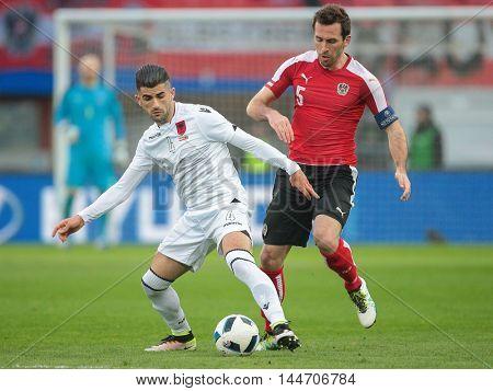 VIENNA, AUSTRIA - MARCH 26, 2016: Christian Fuchs (Austria) and Elseid Hysaj (Albania) fight for the ball in a friendly football game.