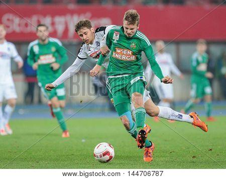 VIENNA, AUSTRIA - OCTOBER 28, 2015: Felix Huspek (SBG) and Philipp Schobesberger (SCR) fight for the ball in an Austrian Football Cup game.