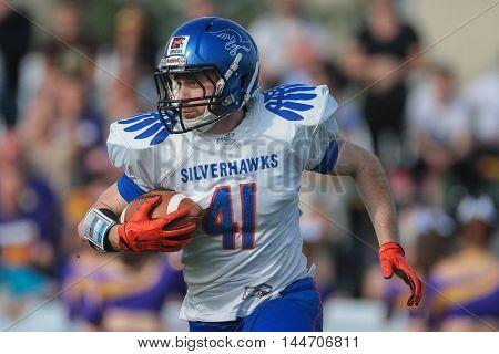 VIENNA, AUSTRIA - APRIL 3, 2016: Andrej Copot (Ljubljana Silverhawks) runs with the ball in a game of the Austrian Football League.