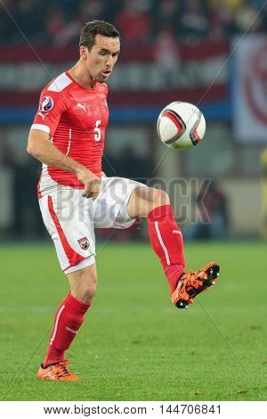 VIENNA, AUSTRIA - OCTOBER 12, 2015: Christian Fuchs (Austria) kicks the ball in an European Championship qualification game.