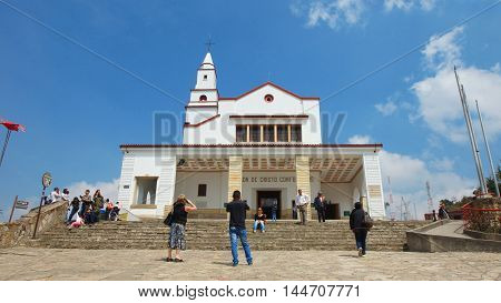 Bogota, Cundinamarca / Colombia - January 19 2016: Tourists taking pictures in front of the Church Santuario del Señor Caido de Monserrate on top of the Mount Monserrate