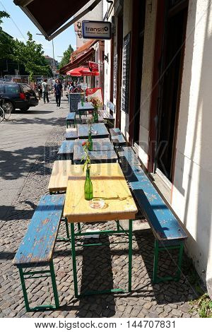 BERLIN, GERMANY, MAY 10, 2016: Street Cafe with no guests in Berlin-Kreuzberg. Kreuzberg is one of the cultural centers of Berlin and popular residence for many creatives