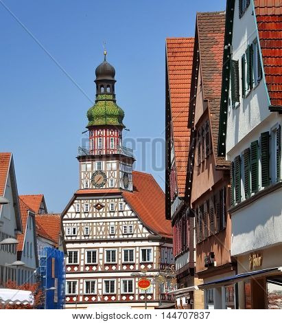 KIRCHHEIM UNTER TECK, GERMANY - APRIL 20, 2016: Street of the old town with half-timbered town hall in perspective. Kirchheim unter Teck, Baden-Württemberg, Germany