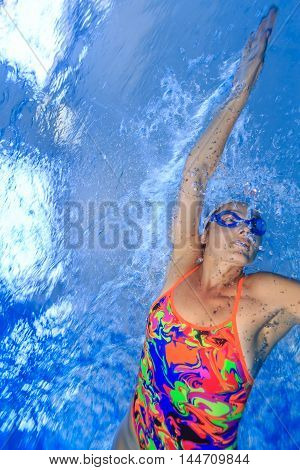Girl athlete in swimming training in a pool