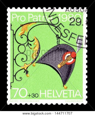 SWITZERLAND - CIRCA 1980 : Cancelled postage stamp printed by Switzerland, that shows Hatter sign.