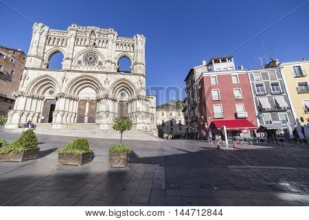 CUENCA SPAIN - APRIL 2 2016: Tourists walk near the facade of the Cuenca's Cathedral The cathedral is dedicated to St Julian gothic english-norman style XII century called the Basilica of Our Lady of Grace, uenca, Spain