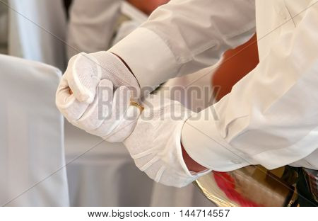 Closeup of a waiter a opening a bottle of champagne