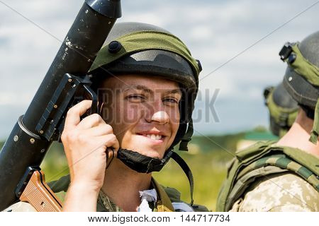 Lviv Ukraine - July 6 2016: Ukrainian-American joint military exercises near the Lviv rapid trident 2016. Commando with granade luncer after atack at simulated enemy positions Lviv.Ukraine.