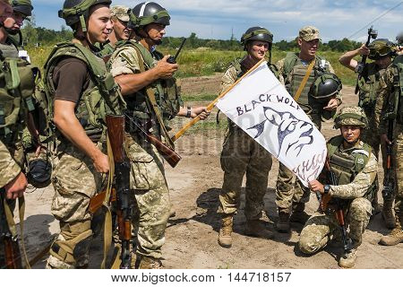 Lviv Ukraine - July 6 2016: Ukrainian-American joint military exercises near the Lviv rapid trident 2016.Commandos with white flag after atack at simulated enemy positions Lviv.Ukraine.