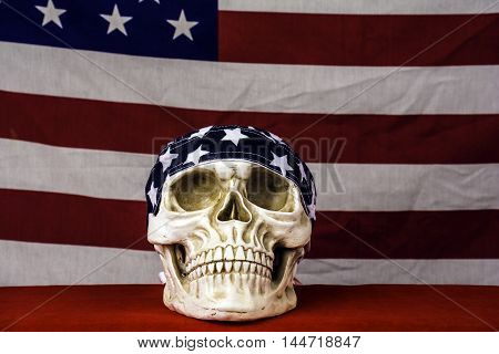 human skull wearing skull cap on red with American flag background