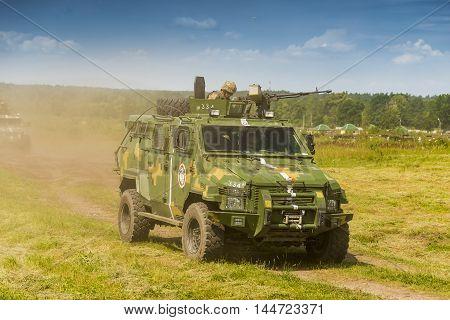 Lviv Ukraine - July 6 2016: Ukrainian-American joint military exercises near the Lviv rapid trident 2016. Ukrainian military vehicle KrAZ Spartan attack simulated enemy Lviv.Ukraine.