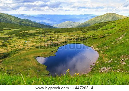Carpathian mountains landscape panorama view from the height Nesamovyte lake under hill