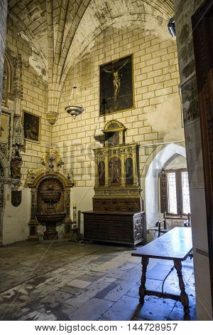 CUENCA SPAIN - August 24 2016: Interior of the Cathedral of Cuenca sacristy entrance of the higher sacristy the Auld mug in the center left an altar and on the right a Gothic window Cuenca heritage of humanity Spain
