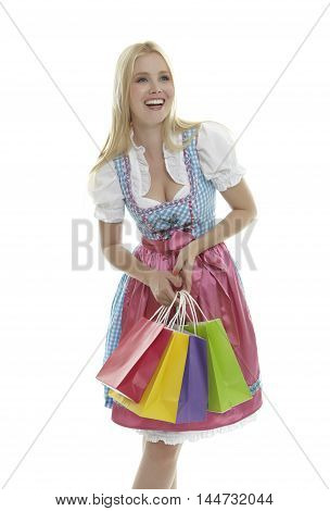 Woman in Dirndl with Shopping Bags in front of white background