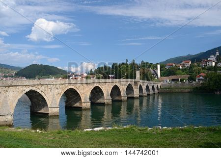 """The Mehmed Pasha Sokolovic Bridge"" (XVI century) historic bridge  over Drina river in Visegrad,Bosnia and Herzegovina poster"
