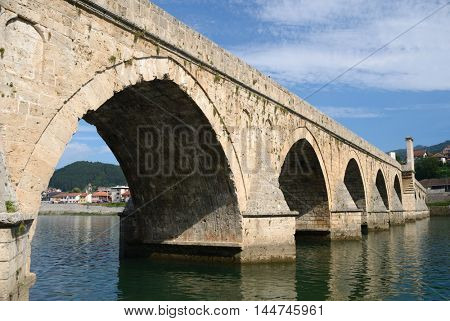 """The Mehmed Pasha Sokolovic Bridge""(XVI century) historic bridge  over Drina river in Visegrad,Bosnia and Herzegovina poster"