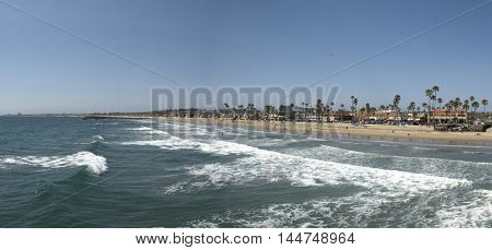 Panoramic view on breaking waves at Newport Beach, Orange County - California