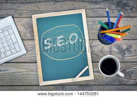 SEO text on school board and coffee on desk
