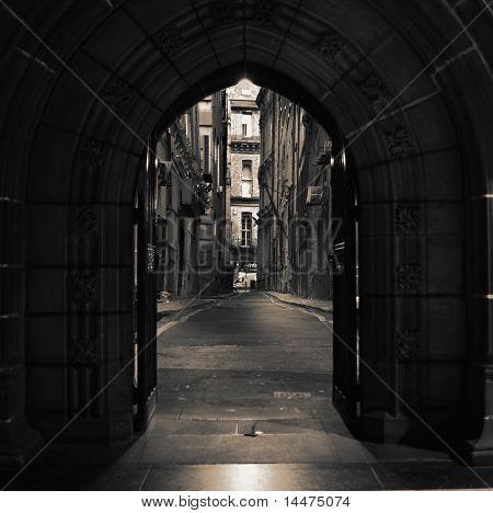 Looking down empty alleyway