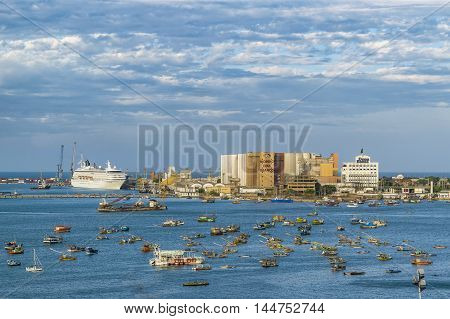 FORTALEZA, BRAZIL, DECEMBER - 2015 - Aerial view shot of group of commercial ships in the waters of the atlantic ocean near the coast of Fortaleza in Brazil