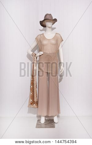 Full length female clothing with hat,scarf on mannequin Full length female clothing with hat,scarf on mannequin