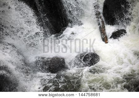Gibbon River hits bottom of Gibbon Falls and splashes and crashes on its way further into Yellowstone National Park.