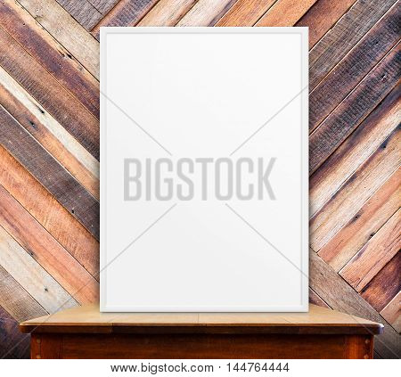 white photo frame at diagonal wall on wood table,mock up for present you design