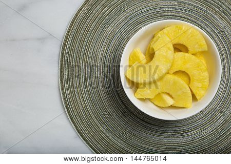 Close-Up Of Organic Pineapple Slices In Bowl