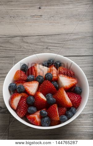 Strawberries and Blueberries in a Bowl with copy area Vertical