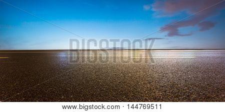 empty asphalt road at twilight