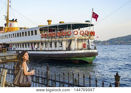Istanbul Turkey - October 2 2012: Ferry in Karaköy pier. Istanbul Ferries continue to serve as a key public transport link for many Thousands of commuters tourists and vehicles per day.