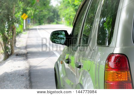 Car parked at the roadside with green nature. Car parked at the roadside. Vehicle parked