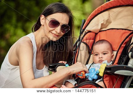 Portrait of mother and baby playing outdoor