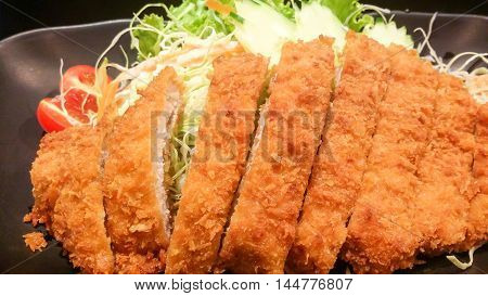 The Crispy Fried Pork With Vegetable In Black Plate, Tonkatsu , Japanese Food